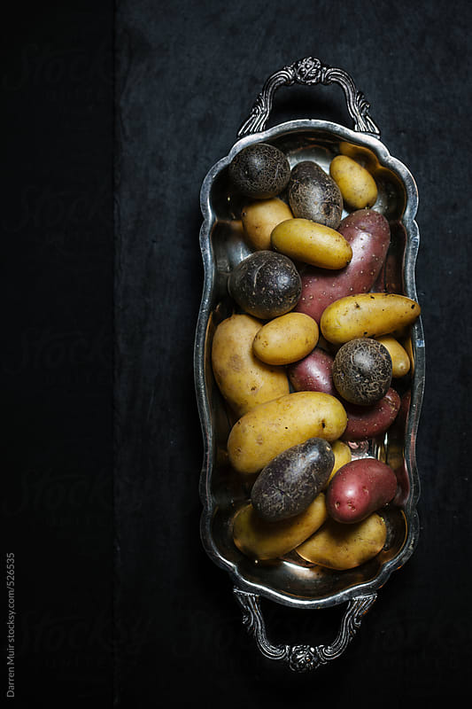 Rainbow potato's. by Darren Muir for Stocksy United
