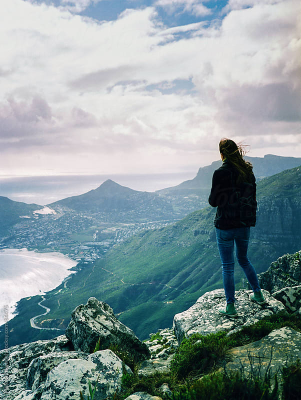 Woman enjoying the view of Hout Bay, Cape Town on a winters day by Micky Wiswedel for Stocksy United