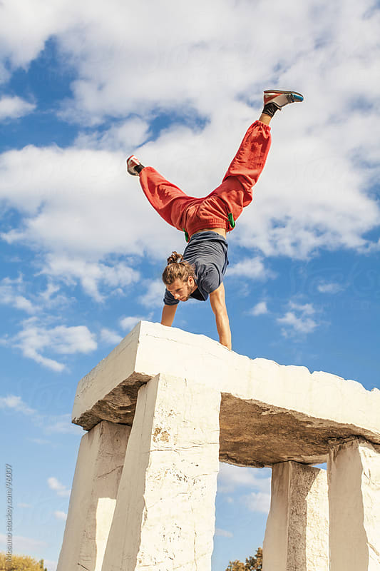 Man Practicing Parkour on the Stone Monument by Mosuno for Stocksy United
