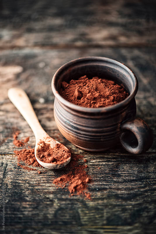 Food: raw cocoa powder in a cup by Ina Peters for Stocksy United