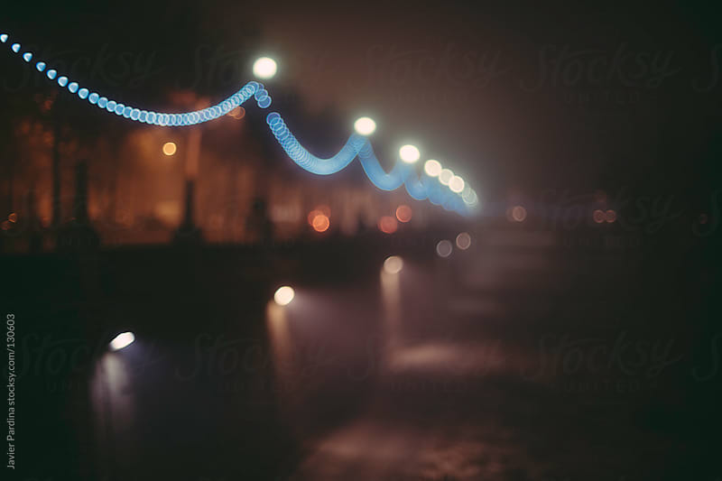 people walking in the city at night by Javier Pardina for Stocksy United