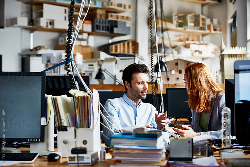 Business People Having Discussion In Office by ALTO IMAGES for Stocksy United