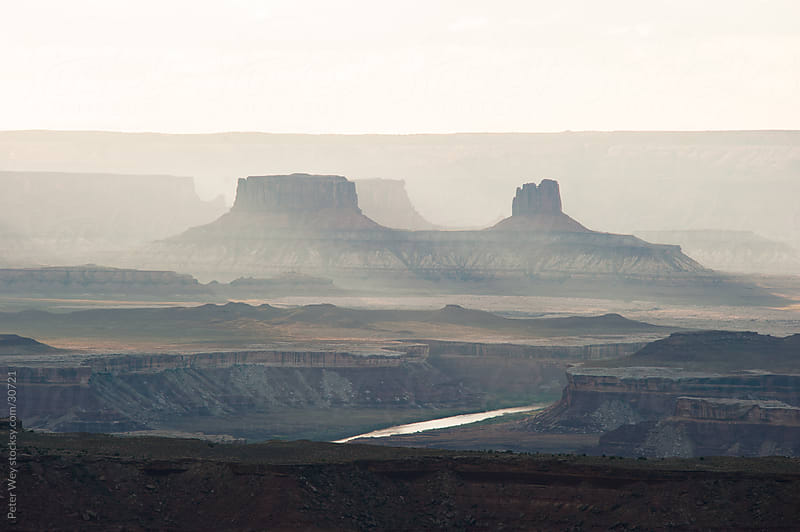 Canyonlands National Park: Distant rock formations at Island of the Sky by Peter Wey for Stocksy United