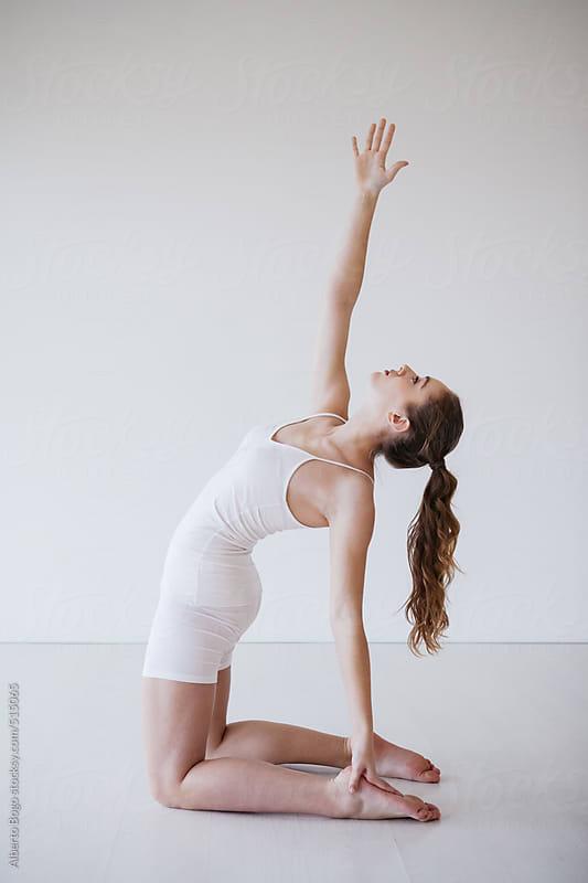 Yoga Practice, Camel Pose (Ustrasana) by Alberto Bogo for Stocksy United