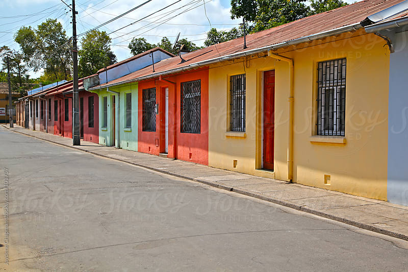 A row of colourful, brightly painted houses in Talca, Chile by Jaydene Chapman for Stocksy United