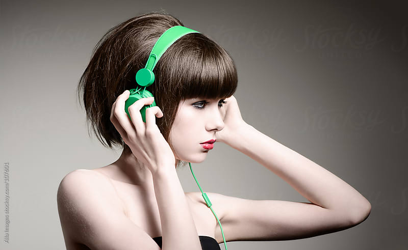 Funky Girl listening to Music  by Aila Images for Stocksy United