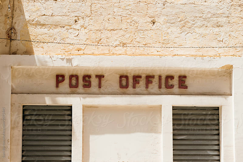 Old post office sign by Sam Burton for Stocksy United