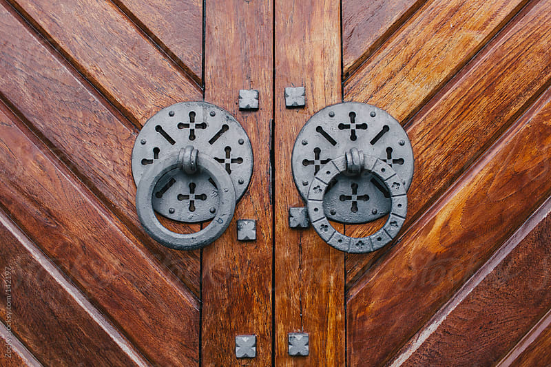 Wooden gate with door knocker rings by Zocky for Stocksy United