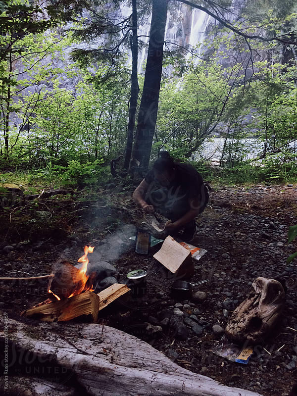 Man Making a Campfire in the Woods by Kevin Russ for Stocksy United