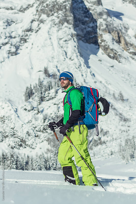 Portrait of a ski tourer in austian winter landscape by Leander Nardin for Stocksy United