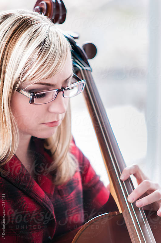 Woman Learning to Play the Cello Practicing at Home by JP Danko for Stocksy United