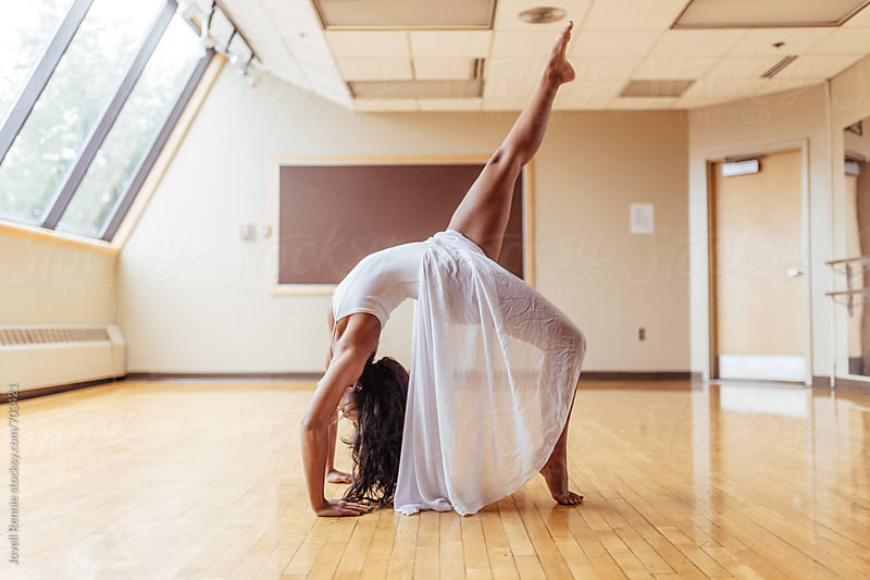 Dancer Warming Up In Studio by Jovell Rennie for Stocksy United