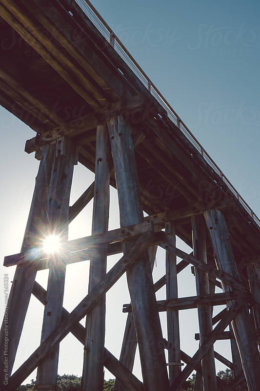 Looking up at a Wooden Railway Bridge by Gary Radler Photography for Stocksy United