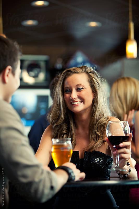 Bar: Girl Talks with Boyfriend at Bar by Sean Locke for Stocksy United