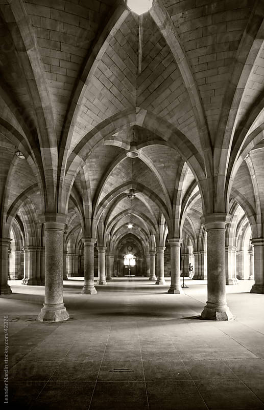 Gothic Arches below the Bute Hall of the Glasgow University by Leander Nardin for Stocksy United
