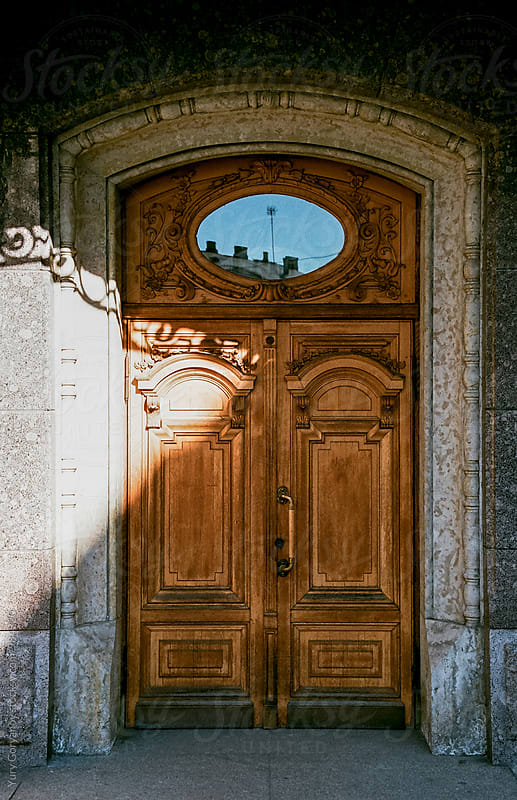 Carved wooden door by Yury Goryanoy for Stocksy United