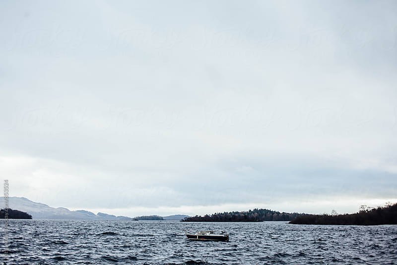 A lone boat by Kitty Gallannaugh for Stocksy United