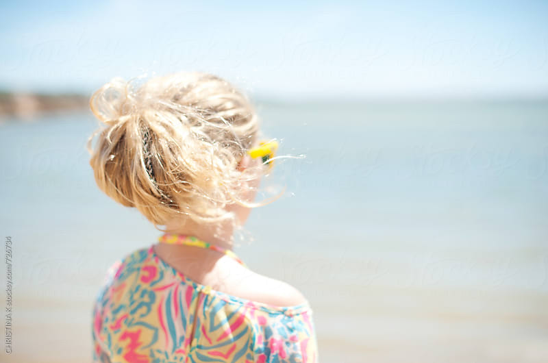 Blond girl looking out to sea by Christina Kilgour for Stocksy United