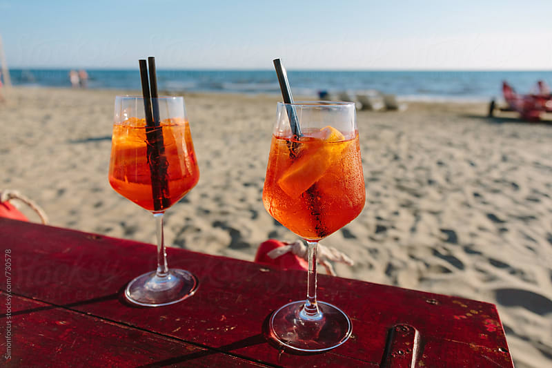 Spritz at the Tuscan beach by Simon DesRochers for Stocksy United
