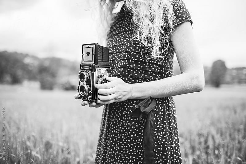 Woman with old camera by michela ravasio for Stocksy United