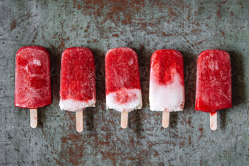 Strawberry popsicles by Pixel Stories for Stocksy United