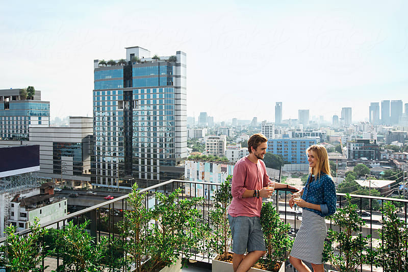 Young Couple Having a Drink Together on a Balcony by Lumina for Stocksy United