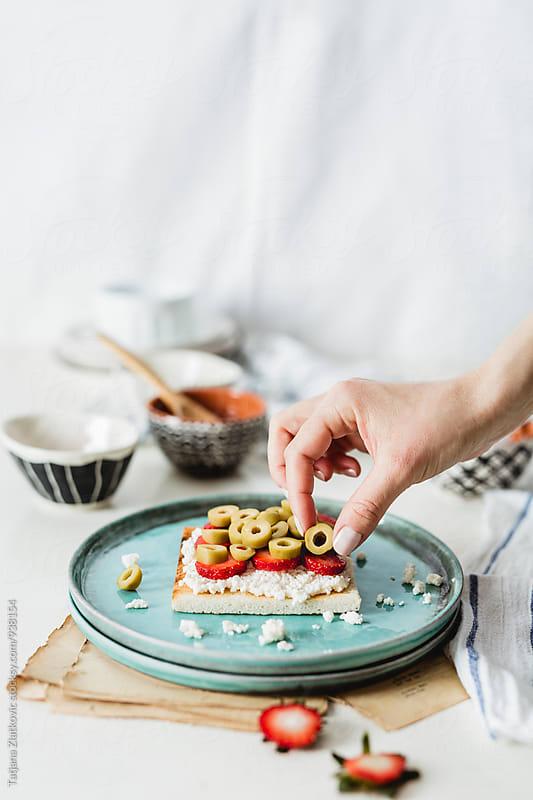 Making strawberry sandwich by Tatjana Zlatkovic for Stocksy United