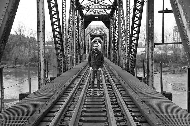 A Man On A Bridge by Carey Haider for Stocksy United