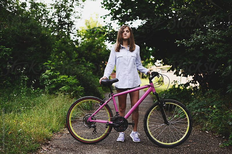 Girl and bicycle by Svetlana Shchemeleva for Stocksy United