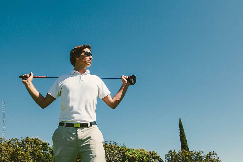 Golfer Having a Rest by VICTOR TORRES for Stocksy United