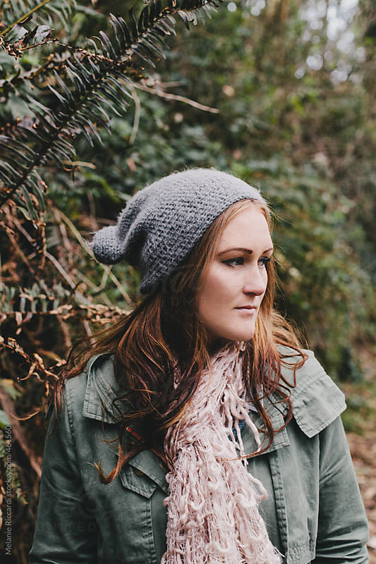 Portrait of a woman in nature during autumn by Melanie Riccardi for Stocksy United