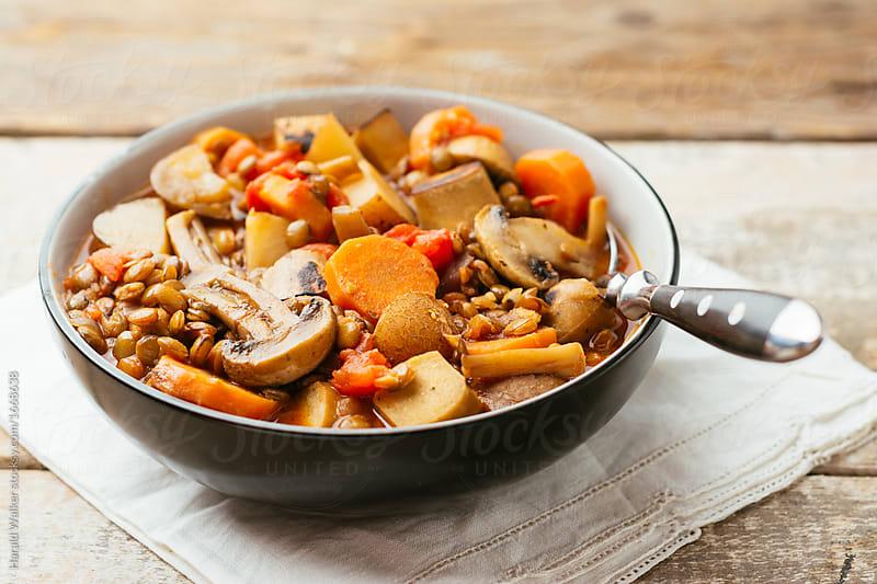 Spicy Lentil Vegan Sausage Stew by Harald Walker for Stocksy United