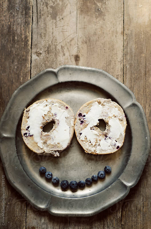 bagel smile by Crissy Mitchell for Stocksy United