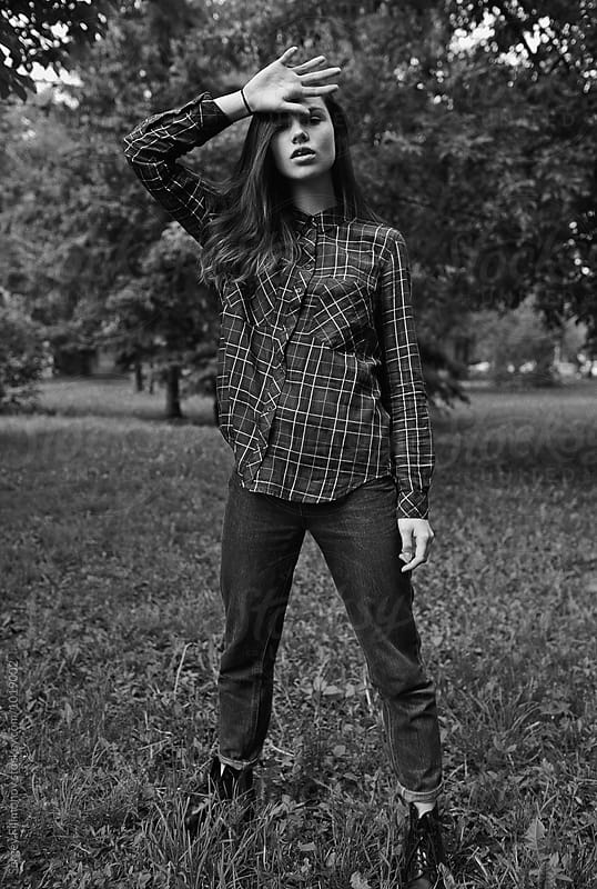Monochrome portrait of a teenager girl by Sergey Filimonov for Stocksy United