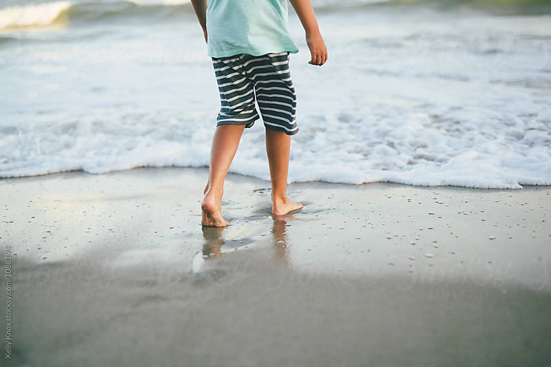 boy on the beach by Kelly Knox for Stocksy United