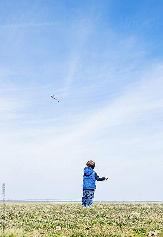 boy flying a kite by Maria Manco for Stocksy United