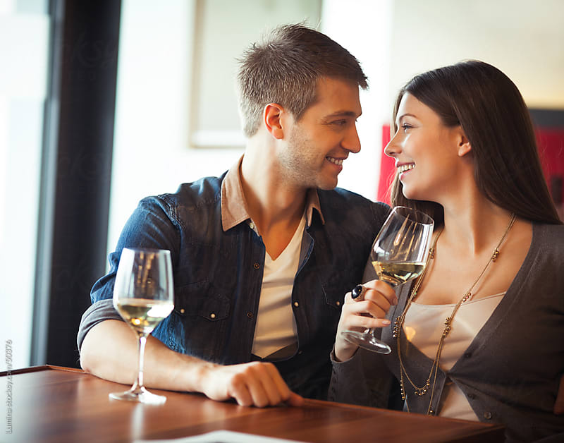 Couple Drinking Wine at a Restaurant by Lumina for Stocksy United