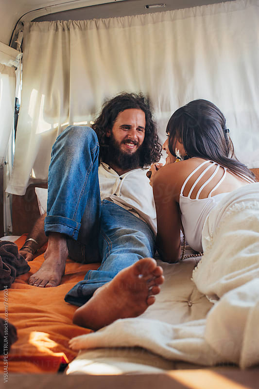 On The Road - Heterosexual Hippie Couple Conversing in Stylish Camper Van by Julien L. Balmer for Stocksy United