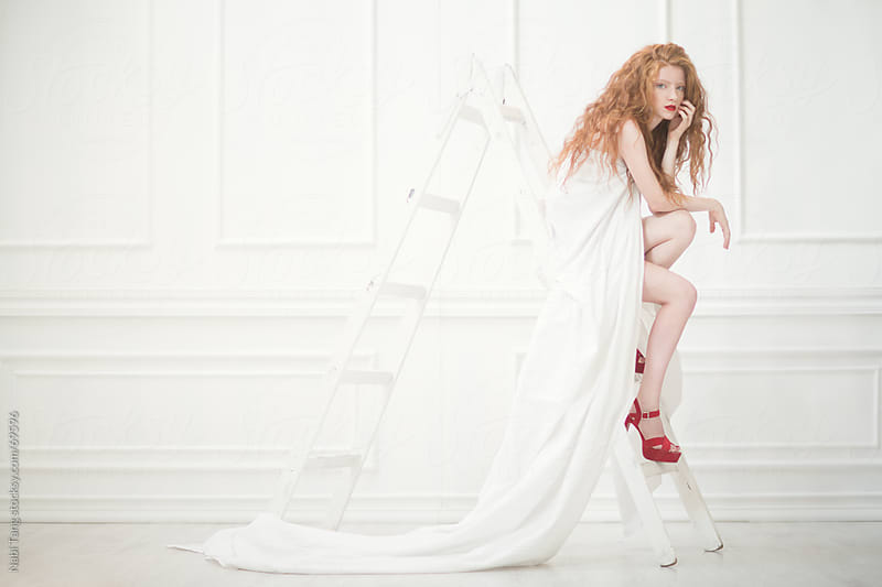 Beautiful red hair girl in white vintage room by Nabi Tang for Stocksy United