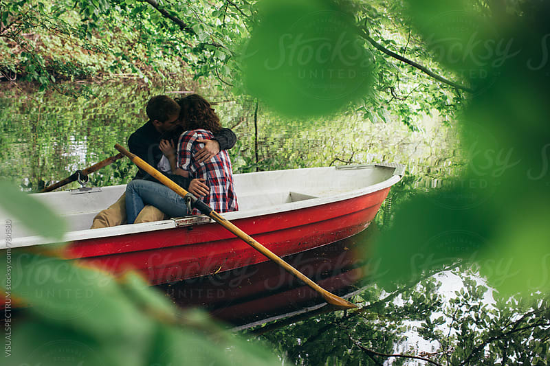 Romance - Heterosexual Couple Making Out on Rowboat by Julien L. Balmer for Stocksy United