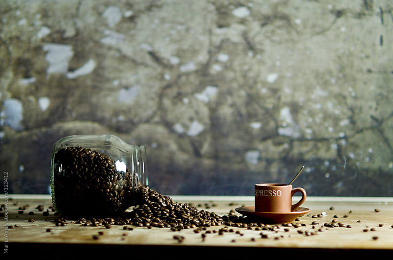 coffee beans and cup of coffee by Marija Anicic for Stocksy United