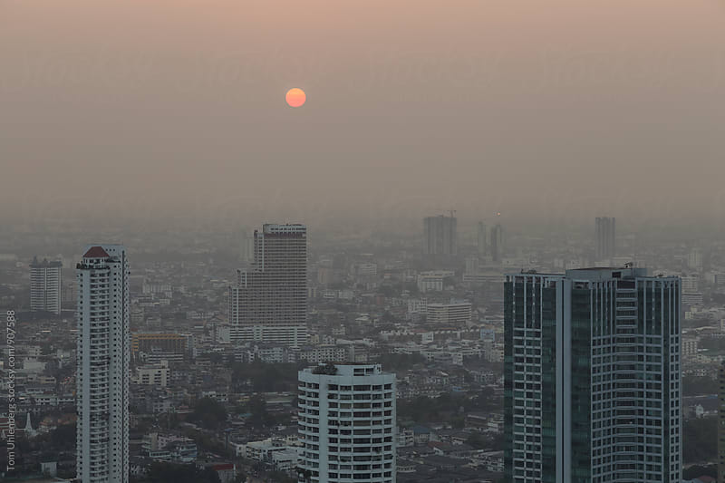Bangkok, Thailand - Hazy Sunset over Skyscrapers near Chao Phraya by Tom Uhlenberg for Stocksy United