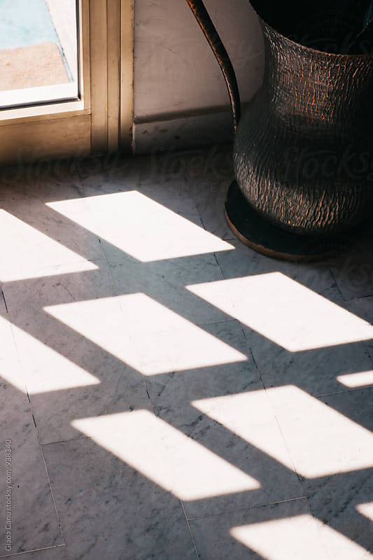 light comes through a window by Giada Canu for Stocksy United