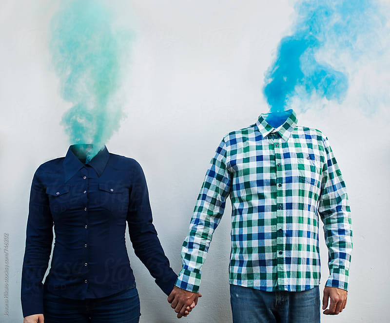 Young couple and smoke bombs concept by Jovana Rikalo for Stocksy United