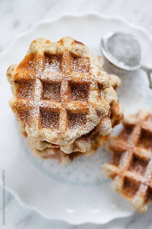 Waffles with icing sugar by Dobránska Renáta for Stocksy United