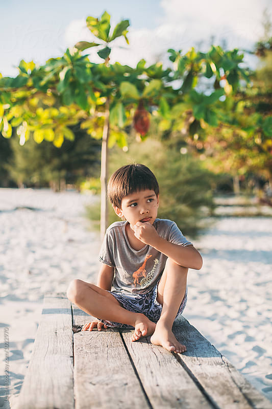 Boy Sitting on the Beach by Lumina for Stocksy United