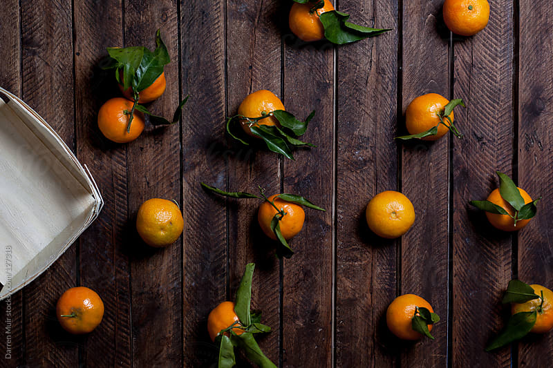 Clementine fruit.  by Darren Muir for Stocksy United