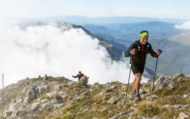 Young sporty hiker climbing a mountain  by Jordi Rulló for Stocksy United