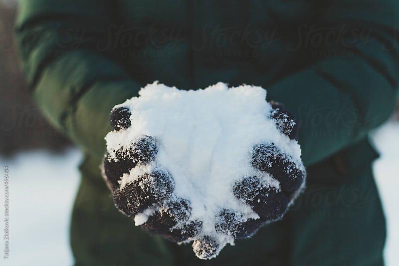 Man holding snow by Tatjana Zlatkovic for Stocksy United
