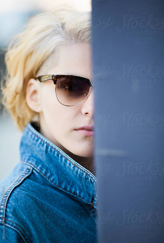 portrait of young woman with sunglasses by Alexey Kuzma for Stocksy United